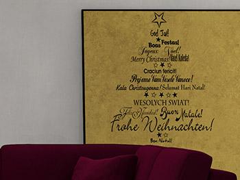Weihnachtliches schriften weihnachtsbaum in schwarz auf gold im
